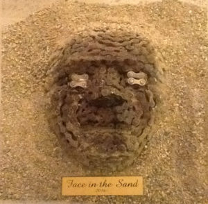 Luca Echampi – Face in the sand