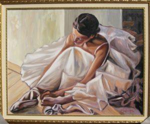 Michele Santonastaso – Ballerina tying her ballet shoe