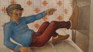 Claudio Giovanni Amore – L'uomo dai grandi piedi appoggiato al muro